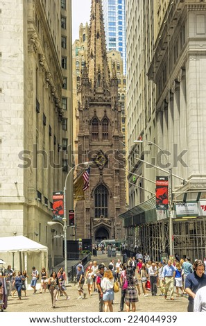 New York, NY - June 23, 2014: Trinity Church, built in 1846, and located at Broadway and Wall streets, is a historic and functioning parish church in the Episcopal Diocese of New York.