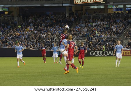New York, NY - May 15, 2015: Adailton of Chicago Fire (4) and david Villa of NYCFC (7) fight for the ball during the game between New York City Football Club and Chicago Fire FC at Yankee Stadium - stock photo