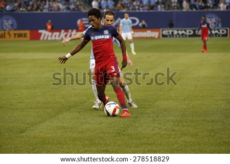 New York, NY - May 15, 2015: Joevin Jones of Chicago Fire (3) & Pablo Alvarez of NYCFC (22) fight for the ball during the game between New York City Football Club and Chicago Fire FC at Yankee Stadium - stock photo