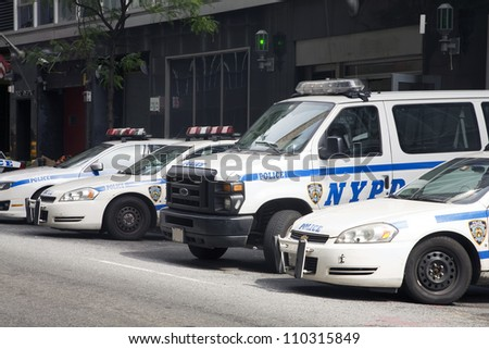 NEW YORK, NY - MAY 30: NYPD police cars parked in front of a police station in New York City on May 30, 2011.  The NYPD is one of the oldest police departments in the US established in 1845. - stock photo
