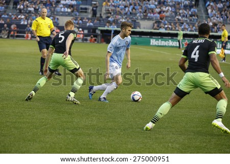 New York, NY - May 3, 2015: Patrick Mullins (14) of NYFC controls ball during MLS game between New York Football Club and Seattle Sounders FC at Yankee Stadium - stock photo
