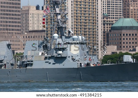 NEW YORK, NY - May 25, 2016: The USS Bainbridge navigates up the Hudson River during the Parade of Ships, kicking off Fleet Week.  This ship was involved in rescue of Captain Richard Phillips.