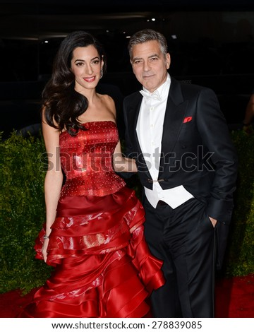 New York, NY  Monday May 04, 2015: Amal Clooney and George Clooney attend 'China: Through The Looking Glass' Costume Institute Gala, held at the Metropolitan Museum of Art in New York City, New York. - stock photo
