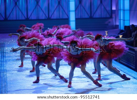 NEW YORK, NY - NOVEMBER 09: Dancers perform on the runway during the 2011 Victoria's Secret Fashion Show at the Lexington Avenue Armory on November 9, 2011 in New York City. - stock photo
