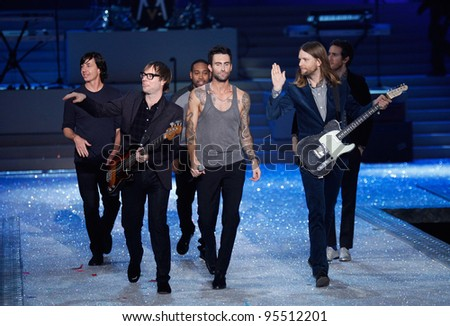 NEW YORK, NY - NOVEMBER 09: Members of Maroon 5 walks the runway during the 2011 Victoria's Secret Fashion Show at the Lexington Avenue Armory on November 9, 2011 in New York City. - stock photo
