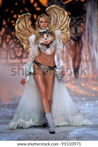 NEW YORK, NY - NOVEMBER 09: Model Candice Swanepoel walks the runway during the 2011 Victoria's Secret Fashion Show at the Lexington Avenue Armory on November 9, 2011 in New York City. - stock photo