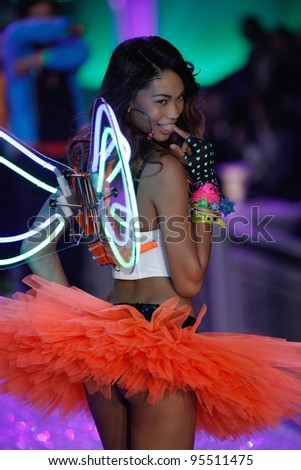 NEW YORK, NY - NOVEMBER 09: Model Chanel Iman walks the runway during the 2011 Victoria's Secret Fashion Show at the Lexington Avenue Armory on November 9, 2011 in New York City. - stock photo