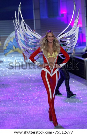 NEW YORK, NY - NOVEMBER 09: Model Lindsay Ellingson walks the runway during the 2011 Victoria's Secret Fashion Show at the Lexington Avenue Armory on November 9, 2011 in New York City. - stock photo