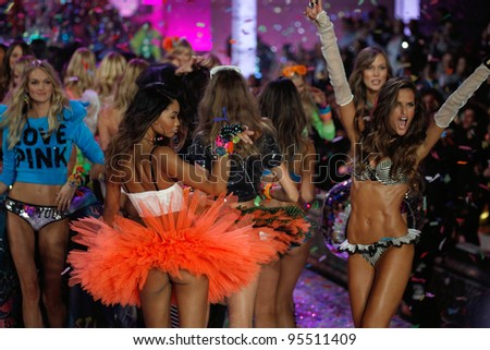NEW YORK, NY - NOVEMBER 09: Models walks the runway finale during the 2011 Victoria's Secret Fashion Show at the Lexington Avenue Armory on November 9, 2011 in New York City. - stock photo
