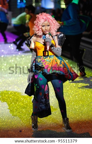 NEW YORK, NY - NOVEMBER 09: Nicki Minaj performs on the runway during the 2011 Victoria's Secret Fashion Show at the Lexington Avenue Armory on November 9, 2011 in New York City. - stock photo