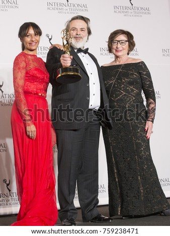 New York, NY - November 20, 2017: Samia Sassi, Xavier Durringer, Joey Fare winner best TV movie mini series pose on stage at press room for 2017 Internation Emmy Awards at Hilton Hotel