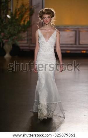 NEW YORK, NY - OCTOBER 08: A model walks during the Claire Pettibone Bridal Fall/Winter 2016 Presentation at The Prince George Ballroom on October 8, 2015 in New York City.  - stock photo