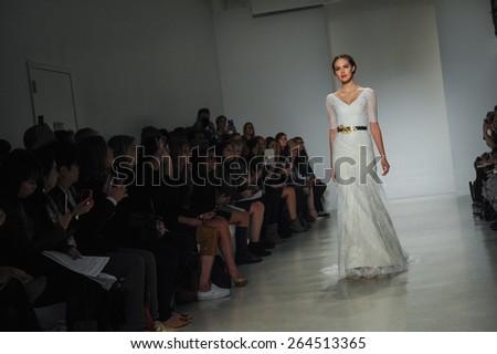 NEW YORK, NY - OCTOBER 10: A model walks runway at Kelly Faetanini runway Show during Fall 2015 Bridal Collection at EZ Studios on October 10, 2014 in NYC. - stock photo