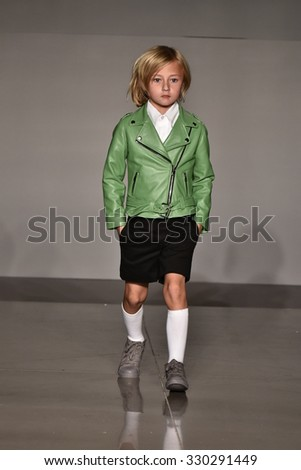 NEW YORK, NY - OCTOBER 17: A model walks runway at Laer Fall/Winter 2016 Runway Show during petiteParade at The Spring Studio on October 17, 2015 in NYC. - stock photo