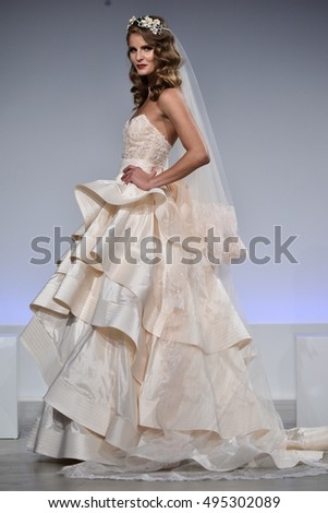 NEW YORK, NY - OCTOBER 6: A model walks the runway at the Anne Barge Fall 2017 Bridal collection show on October 6, 2016 in New York City.