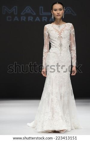 NEW YORK, NY - OCTOBER 11, 2014: A model walks the runway at the Eve Of Milady Fall 2015 Bridal collection show at Pier 94 - Fashion Theater - stock photo