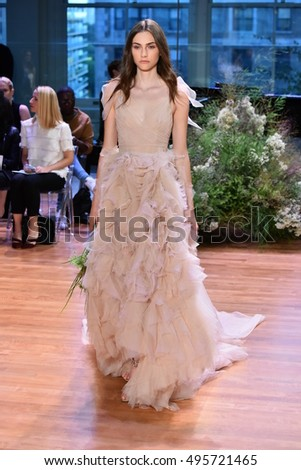 NEW YORK, NY - OCTOBER 7: A model walks the runway at the Monique Lhuillier Fall 2017 Bridal collection show on October 7, 2016 in New York City.