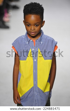 NEW YORK, NY - OCTOBER 18: A model walks the runway during the Anasai preview at petitePARADE Kids Fashion Week at Bathhouse Studios on October 18, 2014 in New York City.