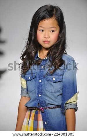 NEW YORK, NY - OCTOBER 18: A model walks the runway during the Anasai preview at petitePARADE Kids Fashion Week at Bathhouse Studios on October 18, 2014 in New York City. - stock photo
