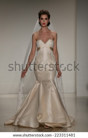 NEW YORK, NY - OCTOBER 10: A model walks the runway during the Anne Barge Fall 2015 Bridal Collection Show on October 10, 2014 in New York City.  - stock photo