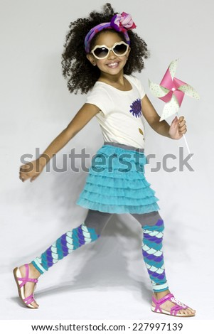 NEW YORK, NY - OCTOBER 19, 2014: A model walks the runway during the Clarks preview at petitePARADE - Kids Fashion Week at Bathhouse Studios - stock photo