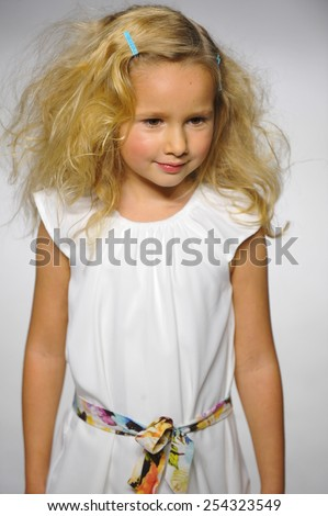 NEW YORK, NY - OCTOBER 18: A model walks the runway during the preview at petitePARADE / Kids Fashion Week at Bathhouse Studios on October 18, 2014 in New York City.