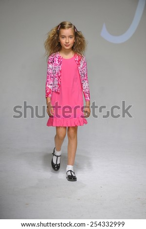 NEW YORK, NY - OCTOBER 18: A model walks the runway during the preview at petitePARADE / Kids Fashion Week at Bathhouse Studios on October 18, 2014 in New York City.  - stock photo