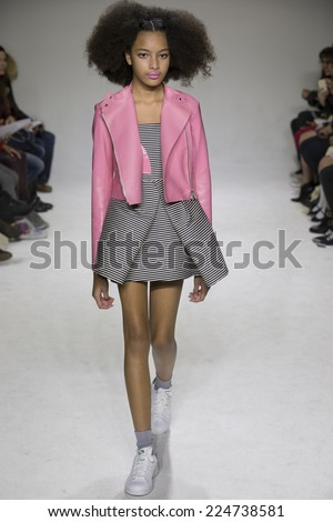 NEW YORK, NY - OCTOBER 19, 2014: Aileen walks the runway during the Bonnie Young preview at petitePARADE - Kids Fashion Week at Bathhouse Studios
