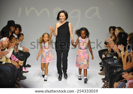 NEW YORK, NY - OCTOBER 18: Designer HJ Chung (C) walks the runway with models during the Imoga preview at petitePARADE / Kids Fashion Week at Bathhouse Studios on October 18, 2014 in New York City - stock photo