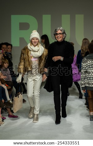NEW YORK, NY - OCTOBER 19: Designer Nina Miner walks the runway with models during the Ruum preview at petitePARADE / Kids Fashion Week at Bathhouse Studios on October 19, 2014 in New York City. - stock photo