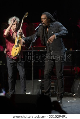New York, NY - October 22, 2015: Keith Richards & Bernard Fowler preform during Great NIght in Harlem fundraising concert for Jazz Foundation of America at Apollo theater - stock photo