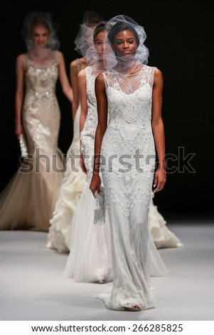 NEW YORK, NY - OCTOBER 11: Model walk runway at Badgley Mischka fashion show during Fall 2015 Bridal Collection at Pier 94 on October 11, 2014 in NYC. - stock photo