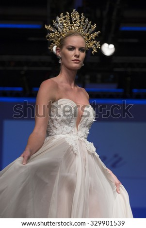 New York, NY - October 11, 2015: Model walks runway for Bridal Couture from Israel by Ester during New York bridal week at Pier 94 - stock photo