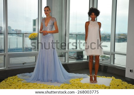 NEW YORK, NY - OCTOBER 13: Models pose during the Fall 2015 Bridal Collection Pamella Roland Presentation at The Glasshouses on October 13, 2014 in New York City. - stock photo