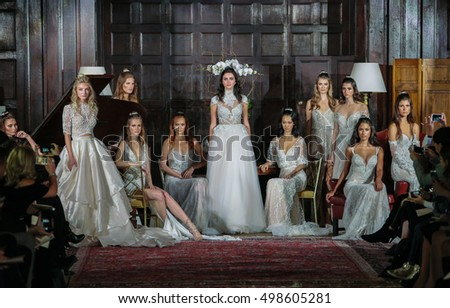 NEW YORK, NY - OCTOBER 8: Models pose on the runway at the Amare Bridal Couture Fall 2017 collection show on October 8, 2016 in New York City.