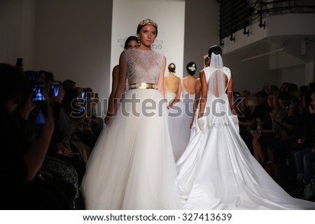 NEW YORK, NY - OCTOBER 10: Models walk during finale of Runway show at the Julie Vino Bridal Fall/Winter 2016 Presentation at EZ Studio on October 10, 2015 in NYC. - stock photo
