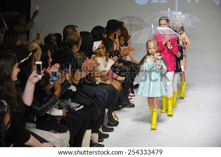 NEW YORK, NY - OCTOBER 18: Models walk the runway during the Oil & Water preview at petitePARADE / Kids Fashion Week at Bathhouse Studios on October 18, 2014 in New York City. - stock photo