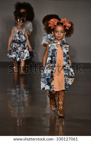 NEW YORK, NY - OCTOBER 17: Models walk the runway finale  at Martin Morgan Fall/Winter 2016 Runway Show during petiteParade at The Spring Stdio on October 17, 2015 in NYC. - stock photo