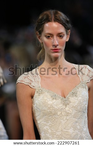 NEW YORK, NY - OCTOBER 10: Models walk the runway finale during the Claire Pettibone Fall 2015 Bridal Collection Show on October 10, 2014 in New York City.  - stock photo