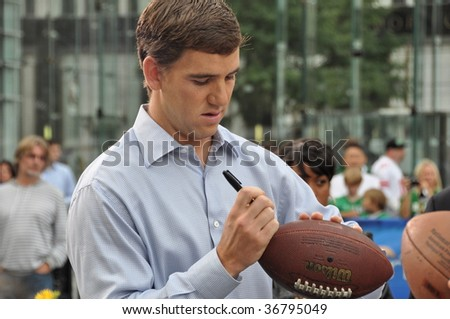 NEW YORK, NY - SEPT 8: Eli Manning, Quarterback of the New York Giants signs autographs while visiting CBS Early Show on Sept 8, 2009 - stock photo