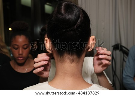 NEW YORK, NY - SEPTEMBER 07: A model getting ready backstage before Victor De Souza Spring 2017 at Gansewoort Hotel on September 7, 2016 in New York City.