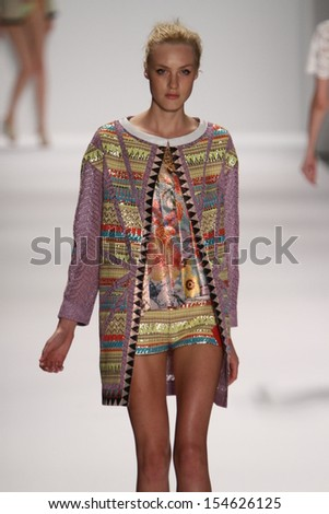 NEW YORK, NY - SEPTEMBER 08: A model walks the Custo Barcelona runway during Spring 2014 Mercedes-Benz Fashion Week at The Stage at Lincoln Center on September 8, 2013 in New York City.