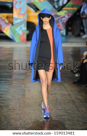 NEW YORK, NY - SEPTEMBER 08: A model walks the runway at DKNY Women's Spring 2014 fashion show during Mercedes-Benz Fashion Week Spring 2014 on September 8, 2013 in New York City.  - stock photo