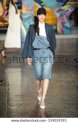 NEW YORK, NY - SEPTEMBER 08: A model walks the runway at DKNY Women's Spring 2014 fashion show during Mercedes-Benz Fashion Week Spring 2014 on September 8, 2013 in New York City.  - stock photo