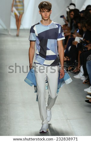 NEW YORK, NY - SEPTEMBER 06: A model walks the runway at Lacoste during Mercedes-Benz Fashion Week Spring 2015  on September 6, 2014 in New York City. - stock photo