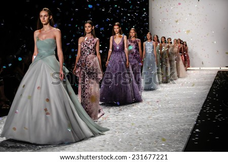 NEW YORK, NY - SEPTEMBER 05: A model walks the runway at Monique Lhuillier during Mercedes-Benz Fashion Week Spring 2015 at Lincoln Center on September 5, 2014 in NYC - stock photo