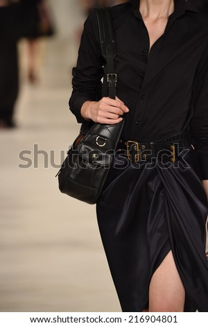 NEW YORK, NY - SEPTEMBER 11: A model walks the runway at Ralph Lauren fashion show during Mercedes-Benz Fashion Week Spring 2015 on September 11, 2014 in New York City.
