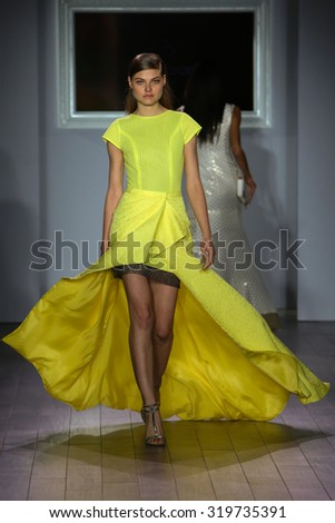 NEW YORK, NY - SEPTEMBER 16: A model walks the runway at Raul Penaranda fashion show during New York Fashion Week Spring 2016 at Style 360 on September 16, 2015 in NYC. - stock photo