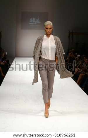 NEW YORK, NY - SEPTEMBER 10: A model walks the runway at the Anje fashion show during Spring 2016 New York Fashion Week at Gotham Hall on September 10, 2015 in New York City. - stock photo