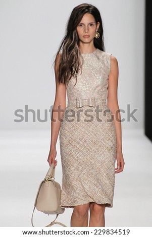 NEW YORK, NY - SEPTEMBER 09: A model walks the runway at the Badgley Mischka fashion show during Mercedes-Benz Fashion Week Spring 2015 at Lincoln Center on September 9, 2014 in NYC - stock photo